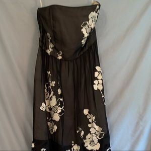 Black dress with embroidered white flowers